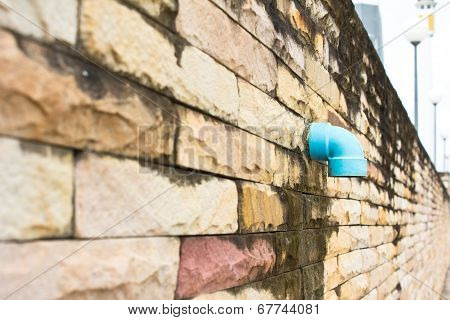 Pipe Drain On A Brick-wall