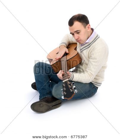 Man Playing His Acoustic Guitar