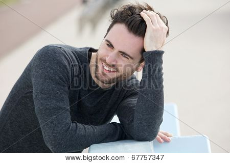 Attractive Man Smiling With Hand In Hair