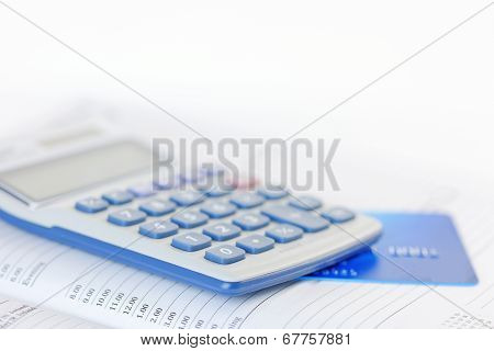 Credit Card And Calculator On A Diary