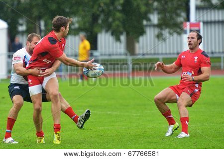 MOSCOW, RUSSIA - JUNE 28, 2014: Alex Webber of Wales make a pass to Will Harries in the match with Russia during the FIRA-AER European Grand Prix Series. Wales won 26-12