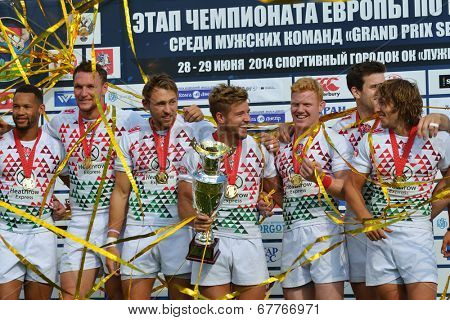 MOSCOW, RUSSIA - JUNE 29, 2014: Team England during award ceremony of the FIRA-AER European Grand Prix Series. The captain Tom Mitchell holds the Cup