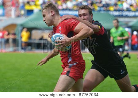 MOSCOW, RUSSIA - JUNE 29, 2014: Semifinal plate match between Belgium (black uniform) and Wales during the FIRA-AER European Grand Prix Series. Wales won 31-5