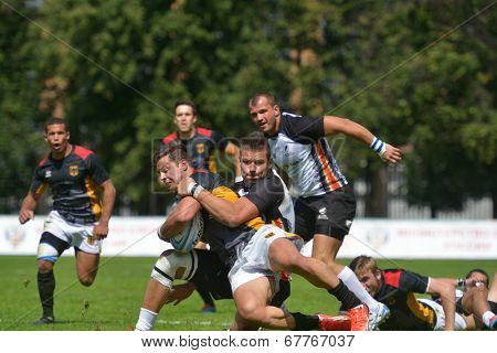 MOSCOW, RUSSIA - JUNE 29, 2014: Match for place 11 between Romania and Germany (dark shirts) during the FIRA-AER European Grand Prix Series. Germany won 26-12