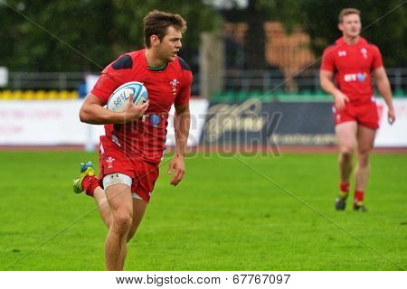 MOSCOW, RUSSIA - JUNE 28, 2014: Alex Webber with the ball in the match between Russia and Wales (red uniforms) during the FIRA-AER European Grand Prix Series. Wales won 26-12