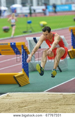 ZHUKOVSKY, MOSCOW REGION, RUSSIA - JUNE 27, 2014: Karol Hoffmann of Poland performs triple jump during Znamensky Memorial. The competitions is one of the European Athletics Outdoor Classic Meetings
