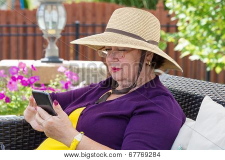 Stylish Senior Lady Using A Smartphone
