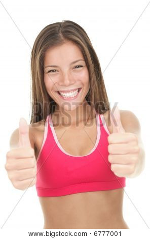 Excited asian fitness woman giving thumbs up