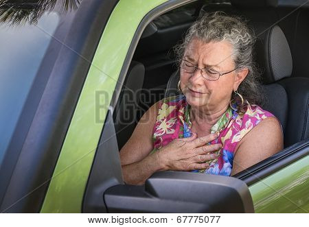 Overheated Frustrated Senior Woman Driver With Sudden Chest Pain