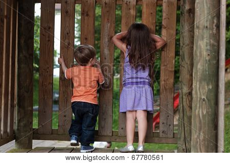 boy and girl playing hide and seek