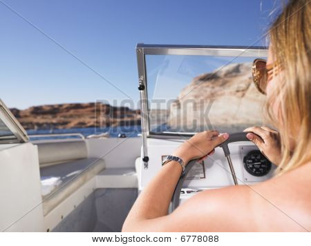 Woman Driving Boat