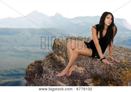 Pretty Girl Sits On A Rock
