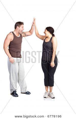 Mujer en la escala de peso