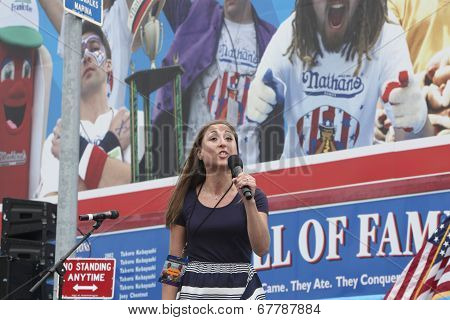 Young woman singing Star Spangled Banner