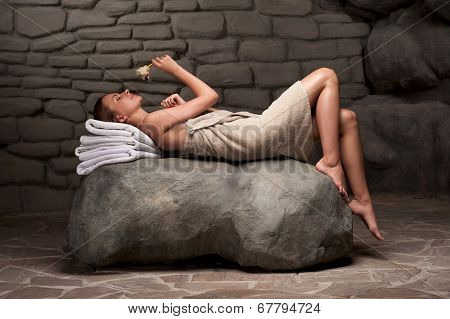 Woman relaxing in spa resort