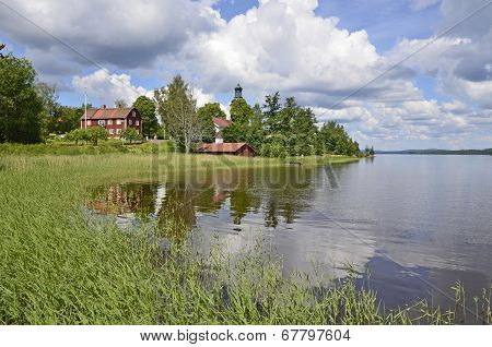 House reflected in scenic lake