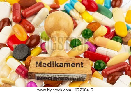 stamp on colorful tablets, symbol photo for drug therapy and prescription