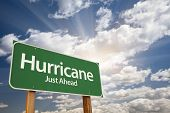 stock photo of hurricane wind  - Hurricane Green Road Sign with Dramatic Clouds and Sky - JPG