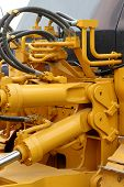 picture of hydraulics  - Hydraulic hoses and pistons of a modern tractor - JPG