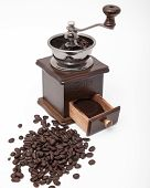 image of coffee grounds  - Isolated vintage coffee bean grinder and fresh ground coffee next to coffee bean - JPG
