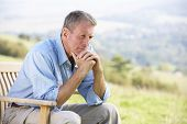 picture of rest-in-peace  - Senior man sitting outdoors - JPG