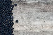 pic of aronia  - Healthy organic dried aronia berries on old wooden background - JPG
