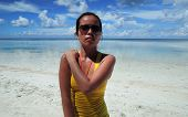 foto of filipina  - Filipina portrait on white sand beach in the morning - JPG