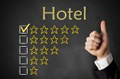 picture of all-inclusive  - thumbs up hotel rating stars on black chalkboard - JPG