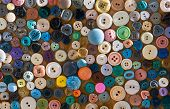 image of texture  - Group of retro colorful fashion buttons on a board - JPG