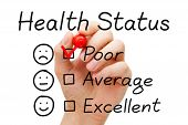 picture of status  - Hand putting check mark with red marker on poor in Health Status evaluation form - JPG