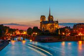 picture of notre dame  - The southern facade of Cathedral of Notre Dame de Paris at sunset - JPG