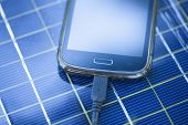 foto of solar battery  - Solar Mobile Phone Chargers on grass in nature - JPG