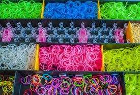 stock photo of rubber band  - Colorful Rainbow loom rubber bands in a box - JPG