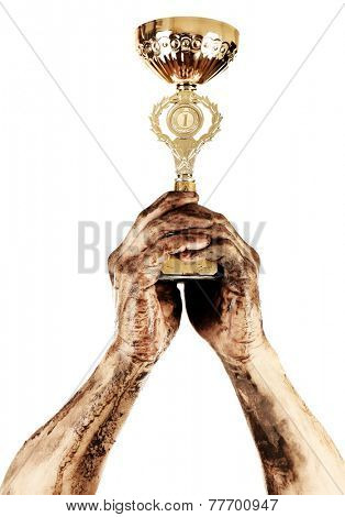 Gold cup in dirty hands isolated on white
