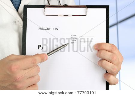 Doctor  Showing By Pen Something On An Empty Form Of   Rx Prescription
