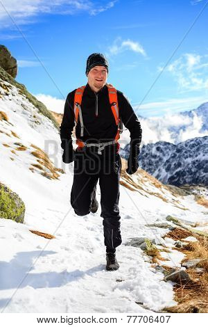 Trail Running In Mountains On Winter Beautiful Day