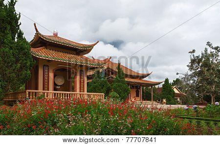 Chua Thien Vuong Pagoda with flowers, Dalat, Vietnam