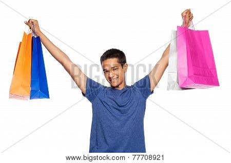 Mixed Race Young Man With Colourful Shopping Bags.