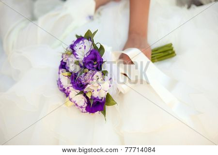 White And Purple Wedding Bouquet With Eustomas In Hands