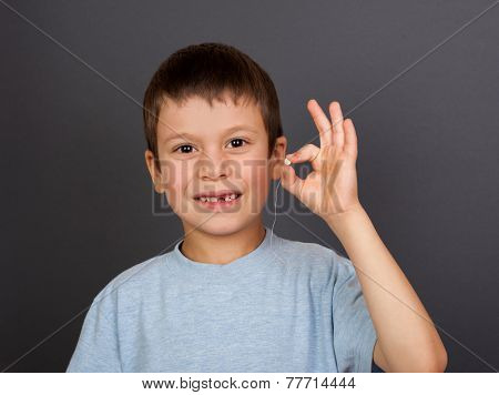 boy with lost tooth on a thread