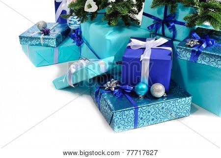 blue gift boxes under Christmas tree isolated on white