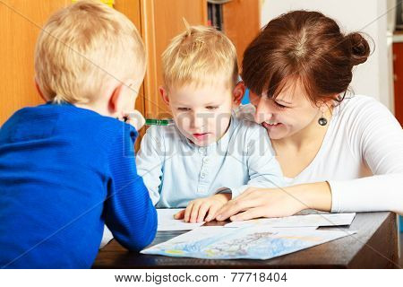 Mother And Children Sons Drawing Together