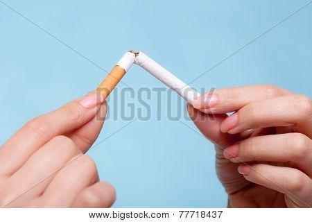 Addiction. Hands Breaking Cigarette. Quit Smoking.