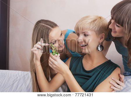 Three Funny Caucasian Girlfriends With Teeth Brackets Discussing Indoors