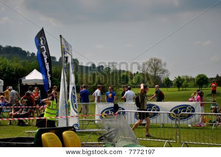 a man runs over the finish line after taking part in a triathlon in wicklow ireland on may 22
