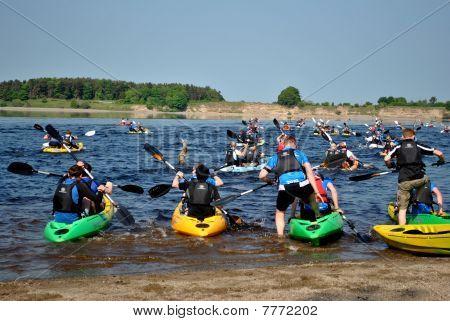 kayaks in a triathlon