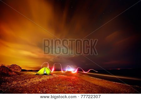 touristic tent on the beach by night - long exposure image