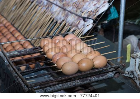 Grilled Egg Skewer With Grilled Squid Skewer On Background