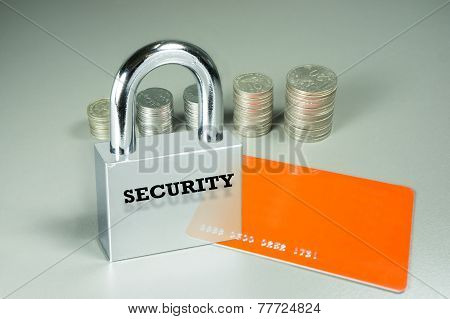 Padlock, Card And Coins In The Background