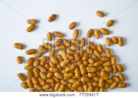 Cleaned, salted peanuts on white background - a top angle shot